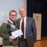 3MT Second Place winner Christopher Timmer with the Dean of the Graduate School